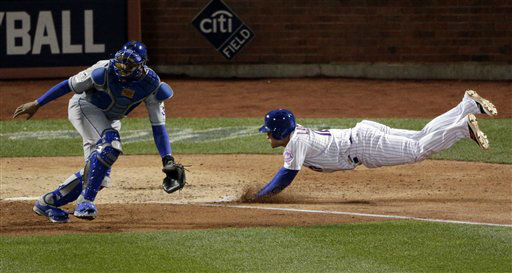 "<div class=""meta image-caption""><div class=""origin-logo origin-image none""><span>none</span></div><span class=""caption-text"">New York Mets' Juan Lagares scores past Kansas City Royals catcher Salvador Perez on a hit by Juan Uribe. (AP Photo/ Charlie Riedel)</span></div>"