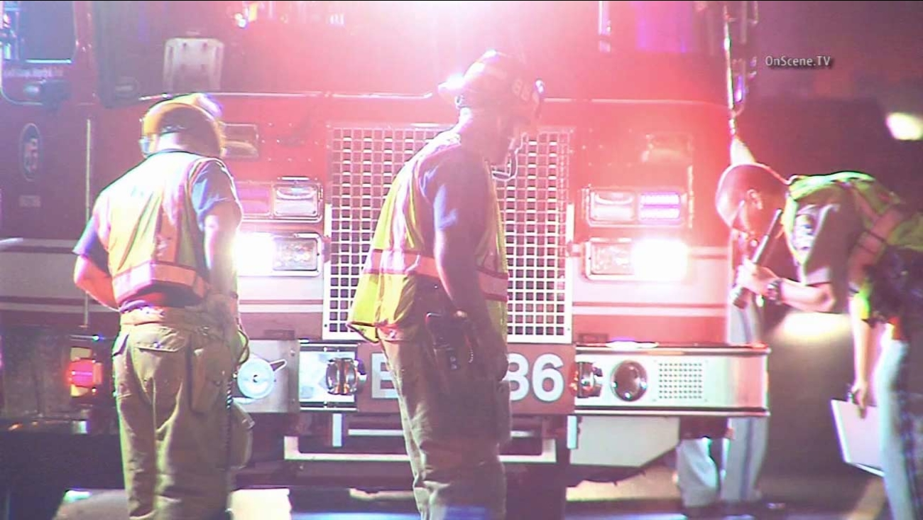 Authorities investigate the scene of a pedestrian struck and killed after walking along the 101 Freeway early Saturday, Oct. 31, 2015.