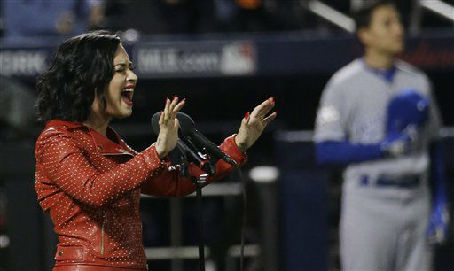 "<div class=""meta image-caption""><div class=""origin-logo origin-image none""><span>none</span></div><span class=""caption-text"">Demi Lovato sings the national anthem before Game 4. (AP Photo/ David J. Phillip)</span></div>"