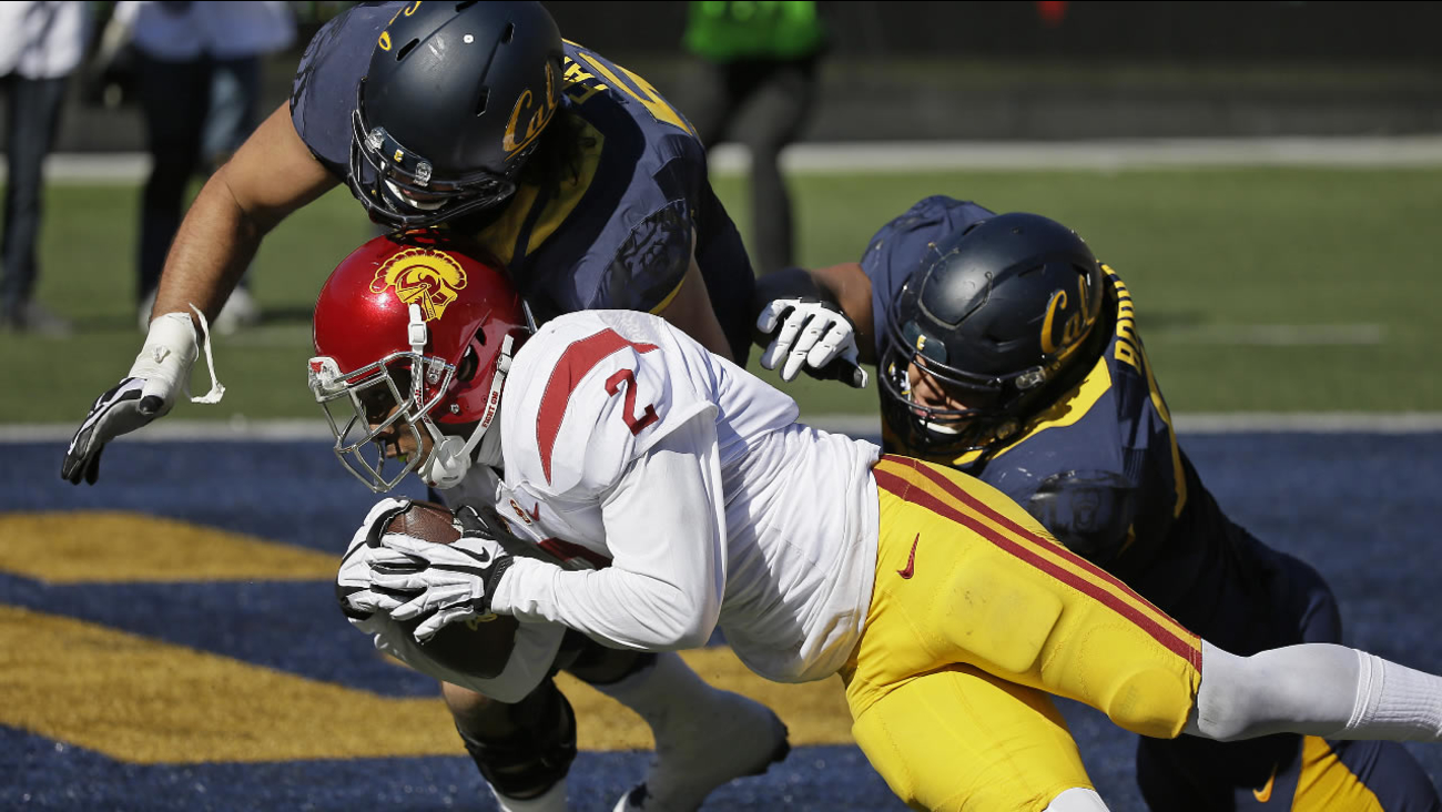 Southern California cornerback Adoree' Jackson scores a touchdown after making a 46-yard interception against California, Saturday, Oct. 31, 2015, in Berkeley, Calif.