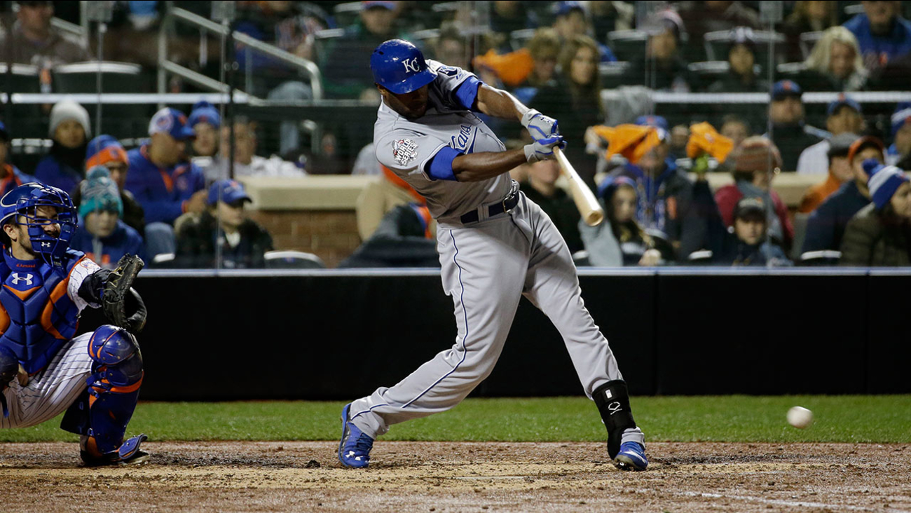 Kansas City Royals' Lorenzo Cain hits an RBI single during the sixth inning of Game 4 of the Major League Baseball World Series against the New York Mets Saturday, Oct. 31, 2015, in New York.