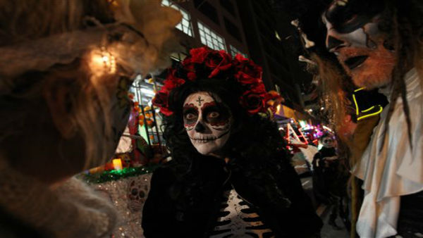 <div class='meta'><div class='origin-logo' data-origin='none'></div><span class='caption-text' data-credit='AP Photo/ Tina Fineberg'>Sharon Hagale, center, waits with others for the start of the Greenwich Village Halloween Parade.</span></div>
