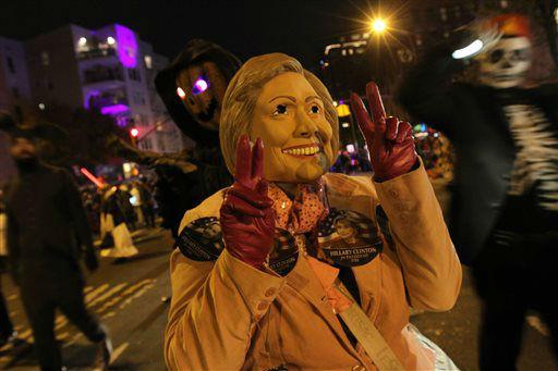 <div class='meta'><div class='origin-logo' data-origin='none'></div><span class='caption-text' data-credit='AP Photo/ Tina Fineberg'>Wearing a Hillary Clinton mask, Isabelle Werder, center, poses for photographs.</span></div>