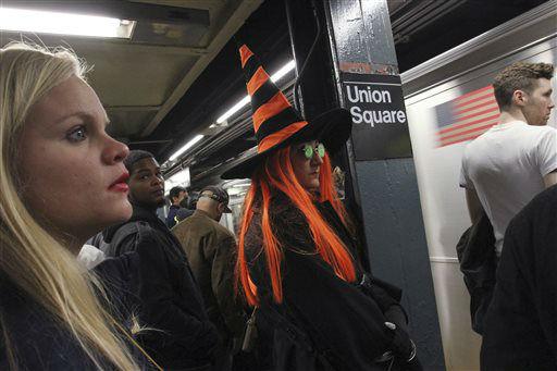 <div class='meta'><div class='origin-logo' data-origin='none'></div><span class='caption-text' data-credit='AP Photo/ Tina Fineberg'>Subway riders wait to board a train at the Union Square stop.</span></div>