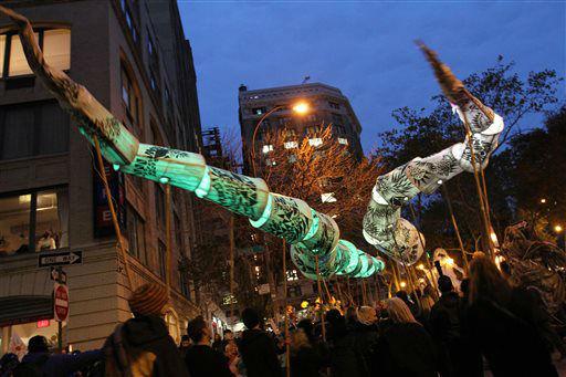<div class='meta'><div class='origin-logo' data-origin='none'></div><span class='caption-text' data-credit='AP Photo/ Tina Fineberg'>People holding snake puppets wait for the start of the Greenwich Village Halloween Parade.</span></div>