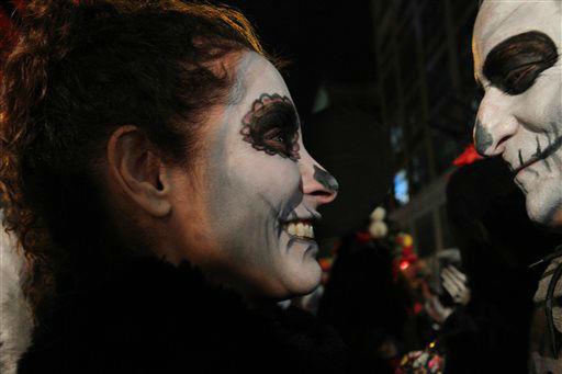 <div class='meta'><div class='origin-logo' data-origin='none'></div><span class='caption-text' data-credit='AP Photo/ Tina Fineberg'>Pilar Secada, left, and her husband Todd Crider wait to take part in the Greenwich Village Halloween Parade.</span></div>
