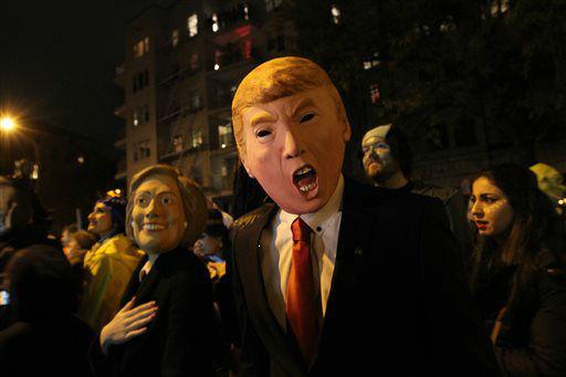 <div class='meta'><div class='origin-logo' data-origin='none'></div><span class='caption-text' data-credit='AP Photo/ Tina Fineberg'>David Jiang, wearing a Donald Trump mask, and his girlfriend Kaja Klupinska, wearing a Hillary Clinton mask.</span></div>