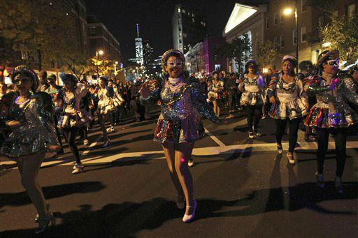 <div class='meta'><div class='origin-logo' data-origin='none'></div><span class='caption-text' data-credit='AP Photo/ Tina Fineberg'>Costumed dancers make their way up Sixth Avenue.</span></div>
