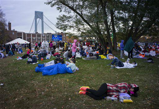 "<div class=""meta image-caption""><div class=""origin-logo origin-image none""><span>none</span></div><span class=""caption-text"">Runners rest near the starting line before the New York City Marathon in the Staten Island borough of New York Sunday, Nov. 1, 2015. (AP Photo/ Craig Ruttle)</span></div>"