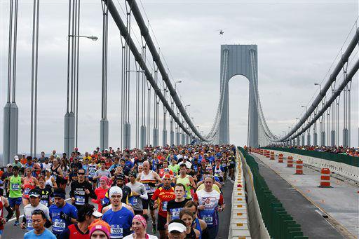 "<div class=""meta image-caption""><div class=""origin-logo origin-image none""><span>none</span></div><span class=""caption-text"">Runners cross the Verrazano-Narrows Bridge at the start of the New York City Marathon, Sunday, Nov. 1, 2015, in New York. (AP Photo/ Jason DeCrow)</span></div>"