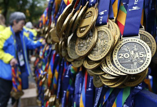 """<div class=""""meta image-caption""""><div class=""""origin-logo origin-image none""""><span>none</span></div><span class=""""caption-text"""">A volunteer unpacks medals for runners who complete the New York City marathon at the marathon finish line in New York, Sunday, Nov. 1, 2015. (AP Photo/ Kathy Willens)</span></div>"""