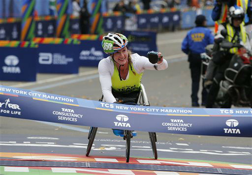 """<div class=""""meta image-caption""""><div class=""""origin-logo origin-image none""""><span>none</span></div><span class=""""caption-text"""">Tatyana McFadden, of the United States, celebrates as she wins the women's wheelchair division.  McFadden set a new course record with 1:35:06 in the event. (AP Photo/ Kathy Willens)</span></div>"""