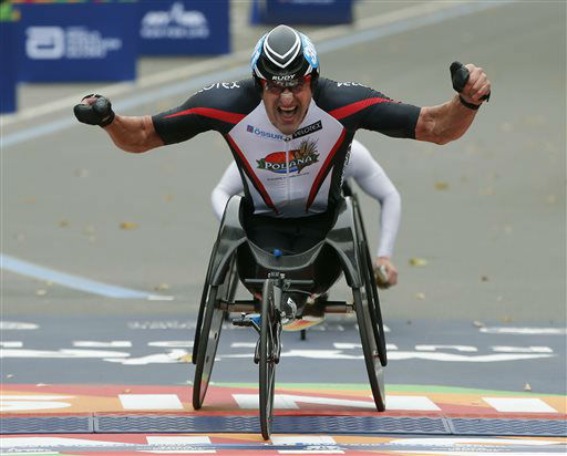 """<div class=""""meta image-caption""""><div class=""""origin-logo origin-image none""""><span>none</span></div><span class=""""caption-text"""">Ernst Van Dyck, of South Africa, celebrates after winning the men's wheelchair division. (AP Photo/ Kathy Willens)</span></div>"""