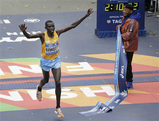 "<div class=""meta image-caption""><div class=""origin-logo origin-image none""><span>none</span></div><span class=""caption-text"">Stanley Biwott of Kenya, left, crosses the finish line first in the men's division at the 2015 New York City Marathon. (AP Photo/ Seth Wenig)</span></div>"