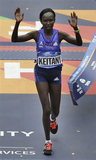 """<div class=""""meta image-caption""""><div class=""""origin-logo origin-image none""""><span>none</span></div><span class=""""caption-text"""">Mary Keitany, of Kenya, crosses the finish line first in the women's division at the 2015 New York City Marathon in New York, Sunday, Nov. 1, 2015. (AP Photo/ Seth Wenig)</span></div>"""