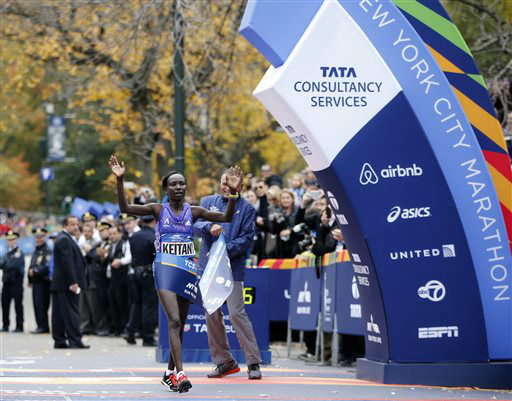 """<div class=""""meta image-caption""""><div class=""""origin-logo origin-image none""""><span>none</span></div><span class=""""caption-text"""">Mary Keitany of Kenya reacts as she crosses the finish line to win the professional women's athlete division. (AP Photo/ Kathy Willens)</span></div>"""