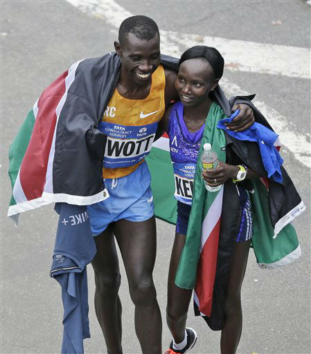 """<div class=""""meta image-caption""""><div class=""""origin-logo origin-image none""""><span>none</span></div><span class=""""caption-text"""">New York City Marathon winners Stanley Biwott, left, and Mary together after finishing , both from Kenya, hug at the finish line. (AP Photo/ Seth Wenig)</span></div>"""