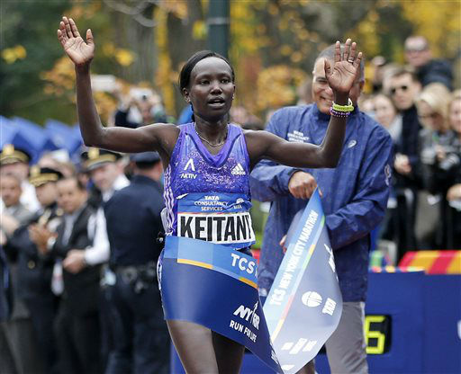 """<div class=""""meta image-caption""""><div class=""""origin-logo origin-image none""""><span>none</span></div><span class=""""caption-text"""">Mary Keitany of Kenya reacts as she crosses the finish line, winning the professional women's athlete division. (AP Photo/ Kathy Willens)</span></div>"""