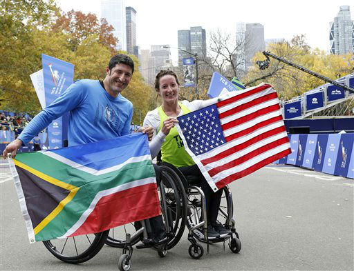 """<div class=""""meta image-caption""""><div class=""""origin-logo origin-image none""""><span>none</span></div><span class=""""caption-text"""">Ernst Van Dyk, of South Africa, left, and Tatyana McFadden, of the United States, pose after taking first place in the mens and women's wheelchair division. (AP Photo/ Kathy Willens)</span></div>"""