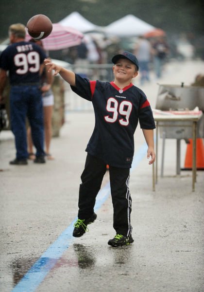 <div class='meta'><div class='origin-logo' data-origin='none'></div><span class='caption-text' data-credit='AP Photo/ Eric Christian Smith'>Houston Texans fans tailgate before an NFL football game against the Tennessee Titans, Sunday, Nov. 1, 2015, in Houston.</span></div>