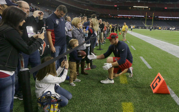 <div class='meta'><div class='origin-logo' data-origin='none'></div><span class='caption-text' data-credit='AP Photo/ Patric Schneider'>Houston Texans defensive end J.J. Watt, right, visits with fans before an NFL football game against the Tennessee Titans, Sunday, Nov. 1, 2015, in Houston.</span></div>