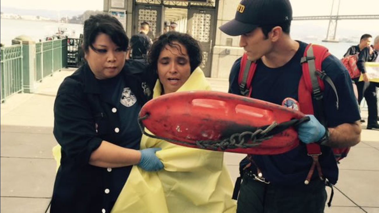 Firefighters are seen rescuing a woman from the San Francisco Bay on Sunday, November 1, 2015.