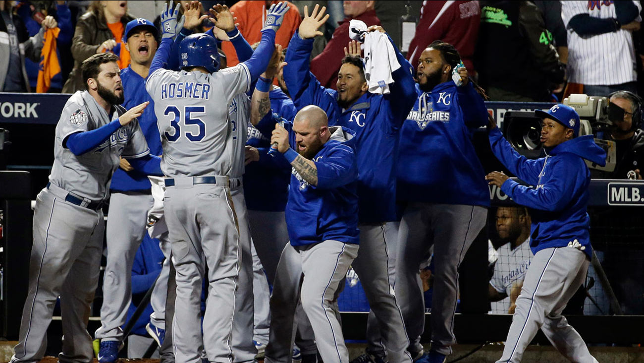 Kansas City Royals' Eric Hosmer is congratulated after scoring during the ninth inning of Game 5 of the Major League Baseball World Series against the New York Mets on Sunday.