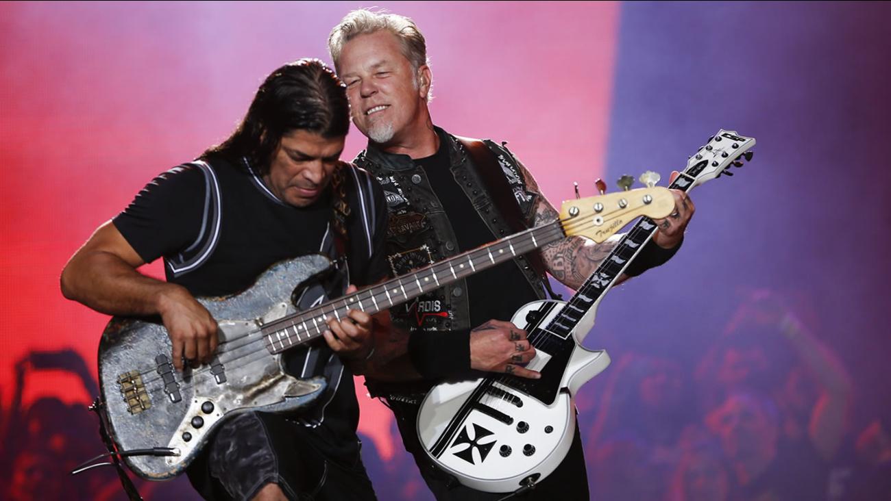 James Hetfield, right, and Robert Trujillo of Metallica perform at the Rock in Rio music festival in Rio de Janeiro, Brazil, early Sunday, Sept. 20, 2015. (AP Photo/Felipe Dana)