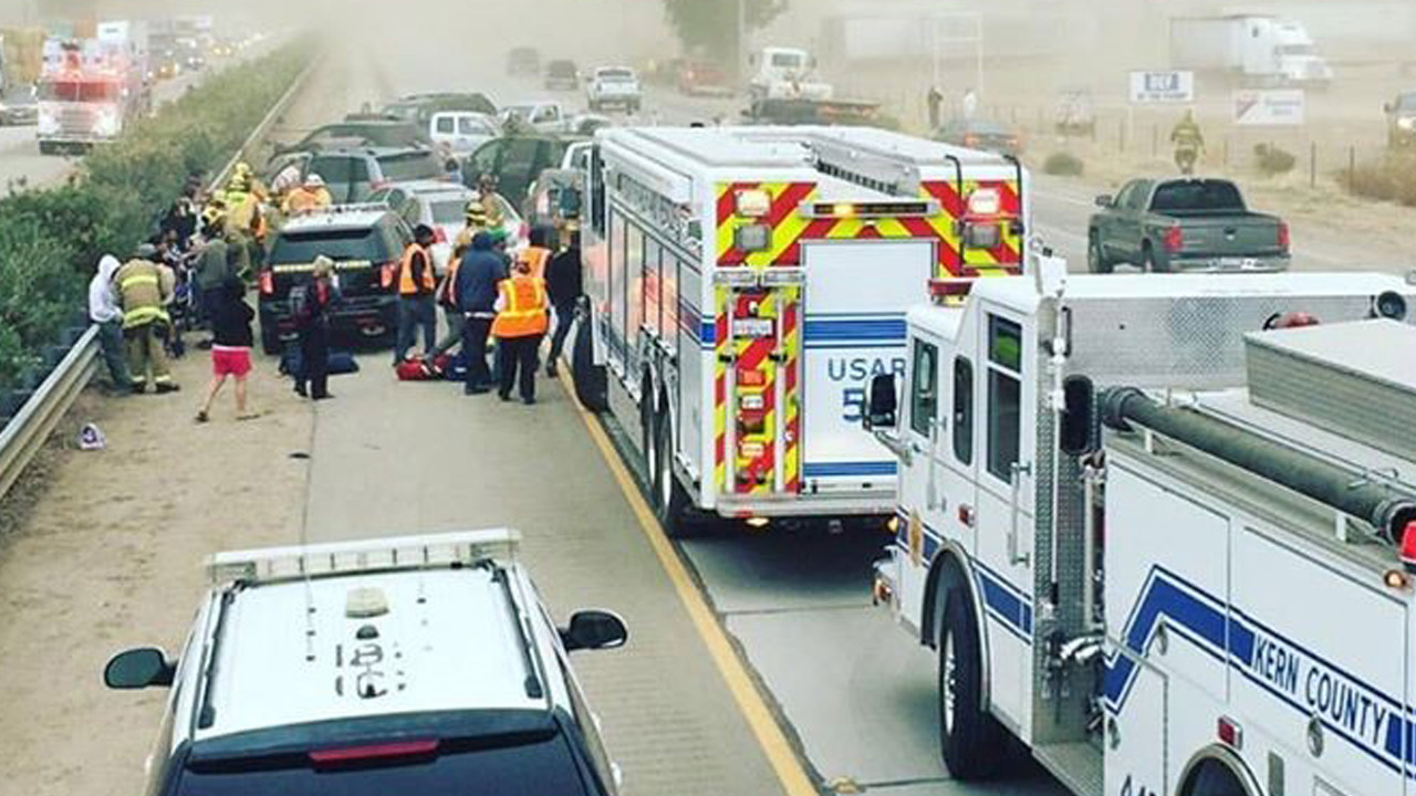 Firefighters and paramedics tend to people who suffered minor injuries in a multiple-car crash on Highway 99 near Bakersfield on Monday, Nov. 2, 2015.