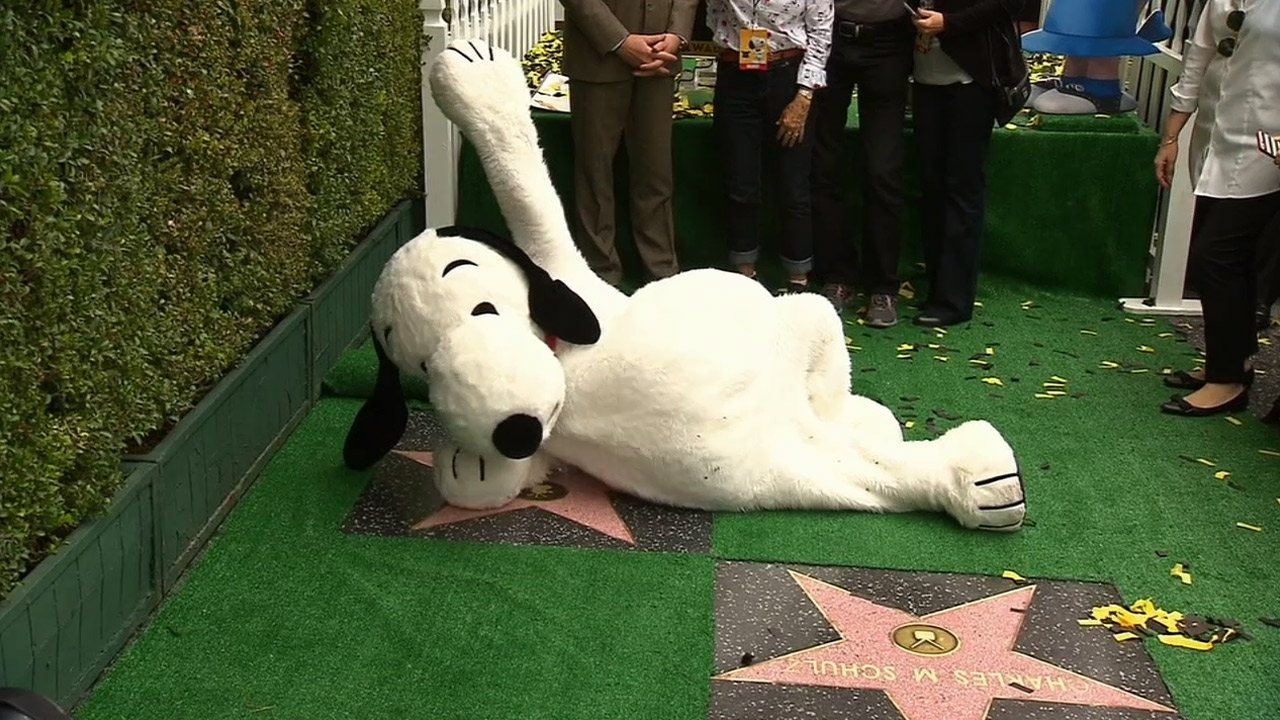 Snoopy poses for photos on his star at the Hollywood Walk of Fame on Monday, Nov. 2, 2015.