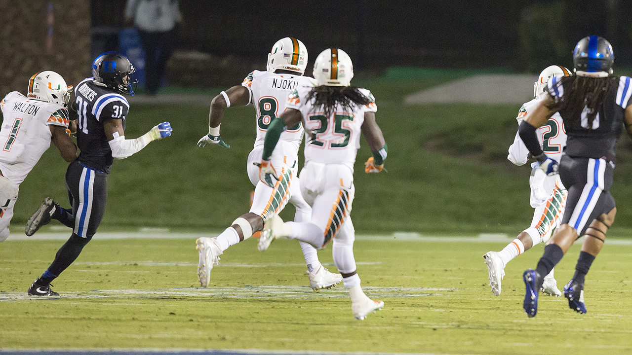 Miami's Corn Elder (29) returns a kickoff, which featured multiple laterals before Elder subsequently received the final lateral, and scores to beat Duke