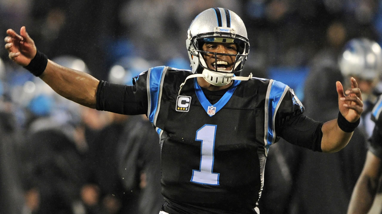 Carolina Panthers' Cam Newton celebrates a Panthers touchdown against the Indianapolis Colts.
