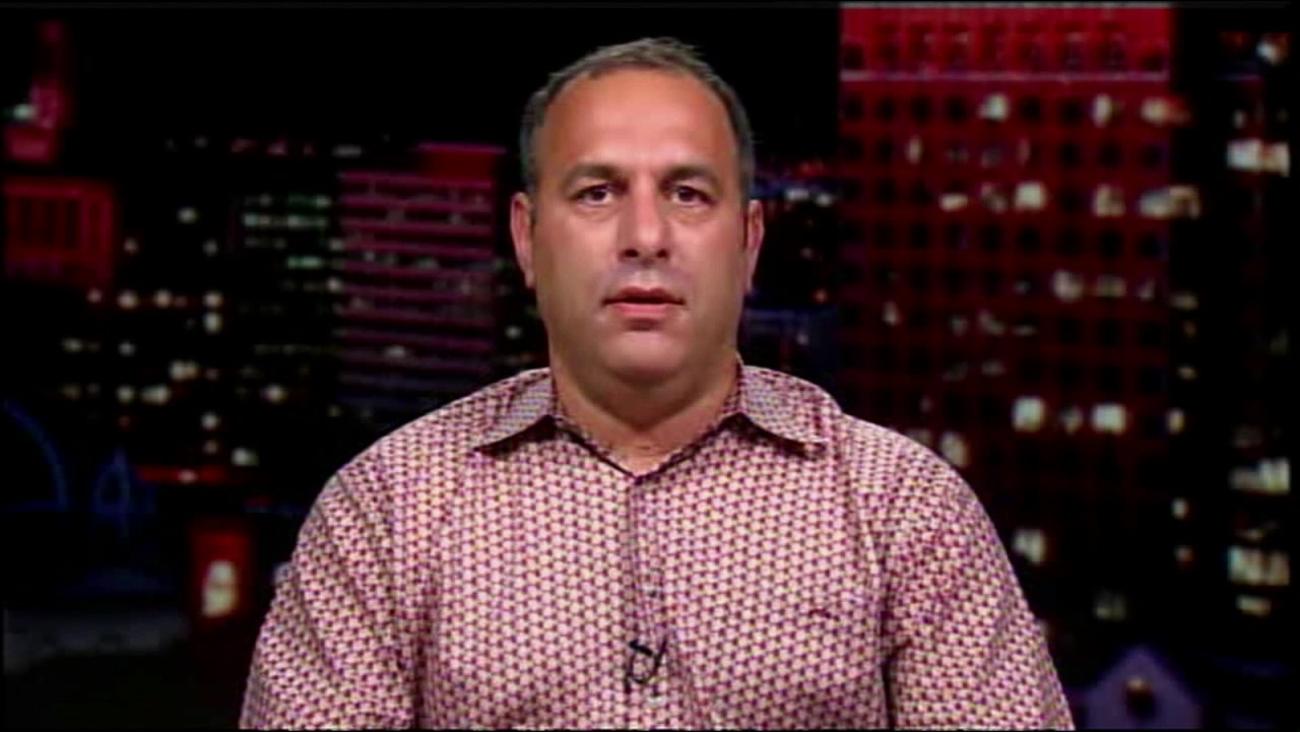 Jason Buzi, the man behind 'Hidden Cash,' is seen in an interview.