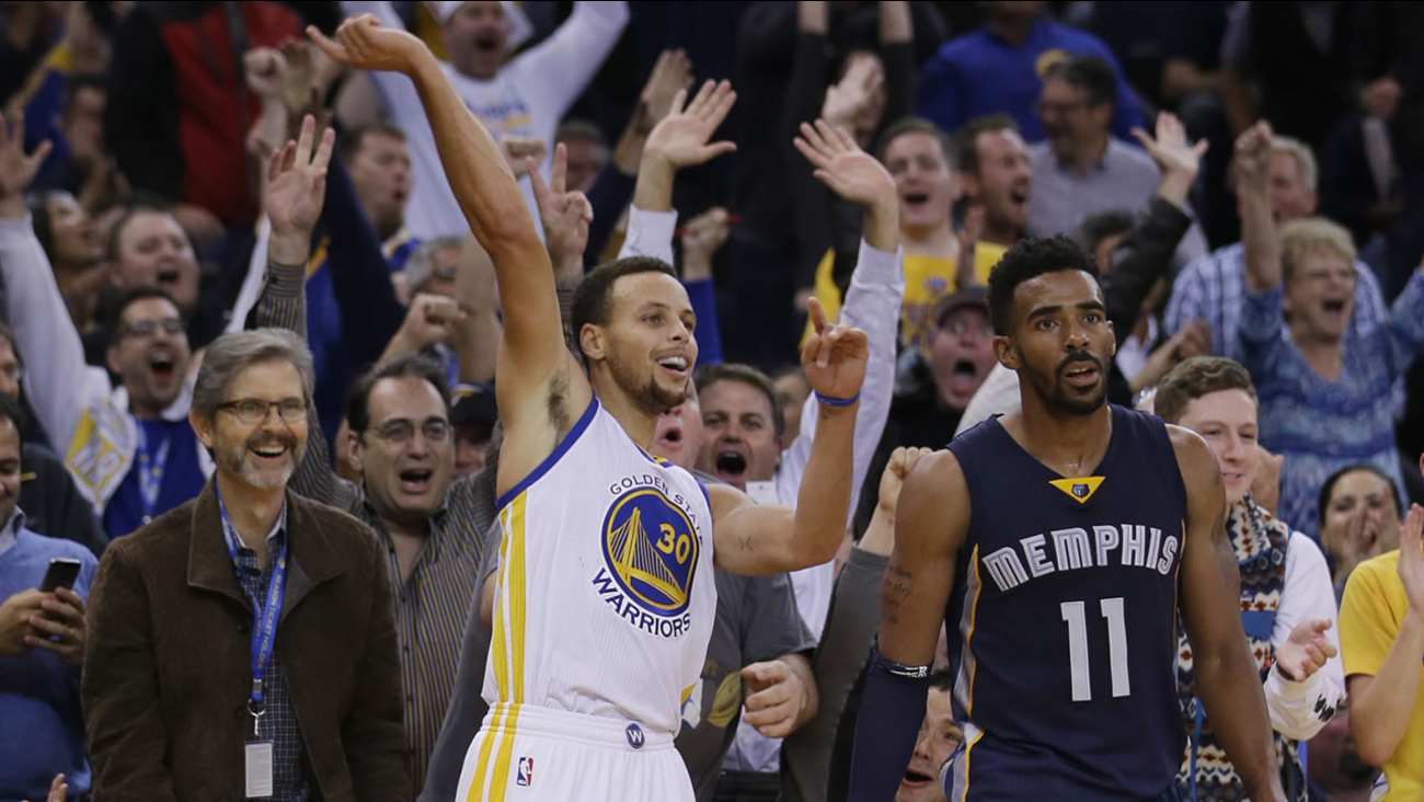 Warriors' Stephen Curry (30) celebrates after making a three-point basket next to Grizzlies' Mike Conley (11) during the second half of a game Nov. 2, 2015, in Oakland, Calif. (AP Photo/Marcio Jose Sanchez)