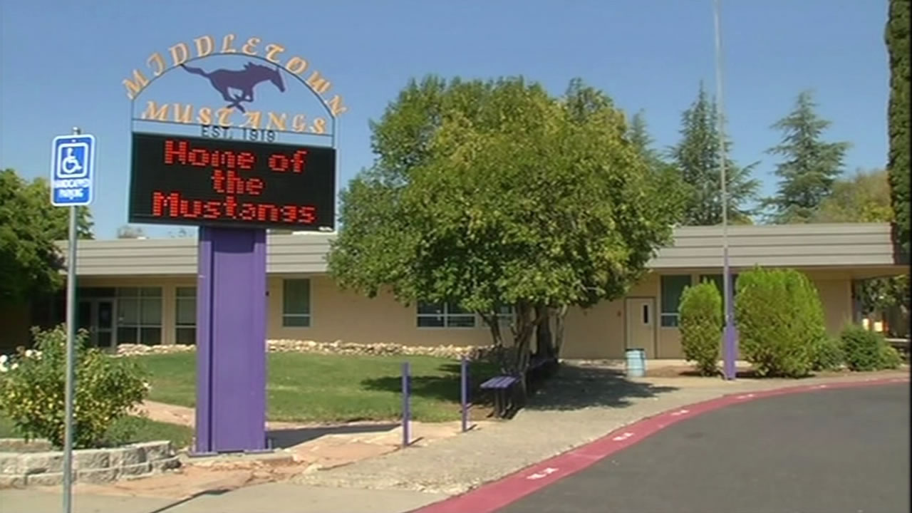 "A sign in front of Middletown High School in Middletown, Calif. flashes ""Home of the Mustangs."""
