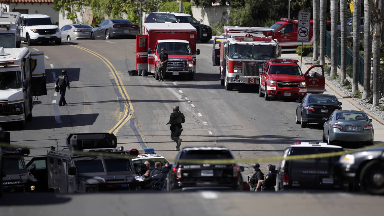San Diego police and fire personnel work to secure a neighborhood in San Diego on Wednesday, Nov. 4, 1015.  (AP Photo/Greg Bull)