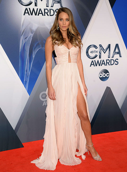 <div class='meta'><div class='origin-logo' data-origin='none'></div><span class='caption-text' data-credit='Evan Agostini/Invision/AP'>Hannah Davis arrives at the 49th annual CMA Awards at the Bridgestone Arena on Wednesday, Nov. 4, 2015, in Nashville, Tenn.</span></div>