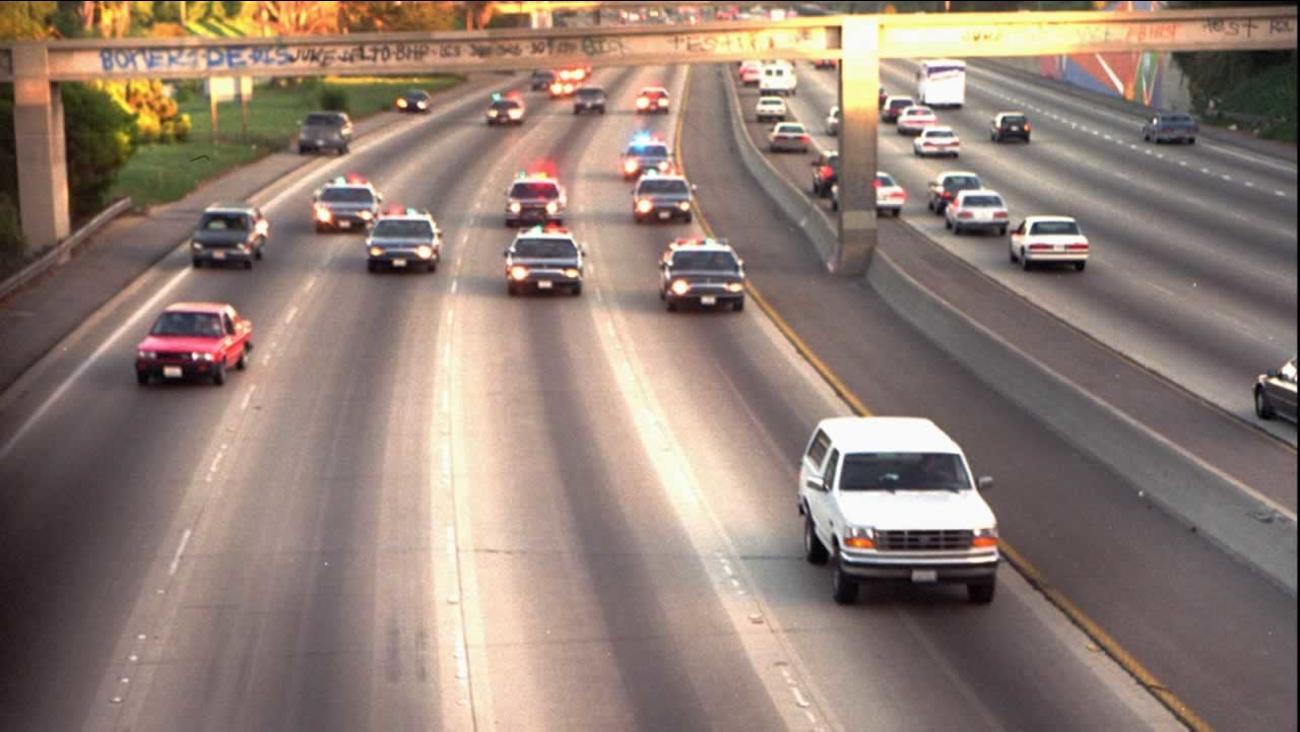A white Ford Bronco, driven by Al Cowlings and carrying O.J. Simpson, is chased by police cars as it travels on a southern California freeway in Los Angeles in this June 17, 1994.