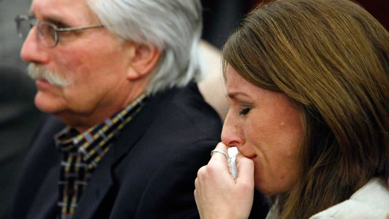 Fred Goldman, background left, and his daughter Kim Goldman appear in court during O.J. Simpson's sentencing hearing at the Clark County Regional Justice Center.