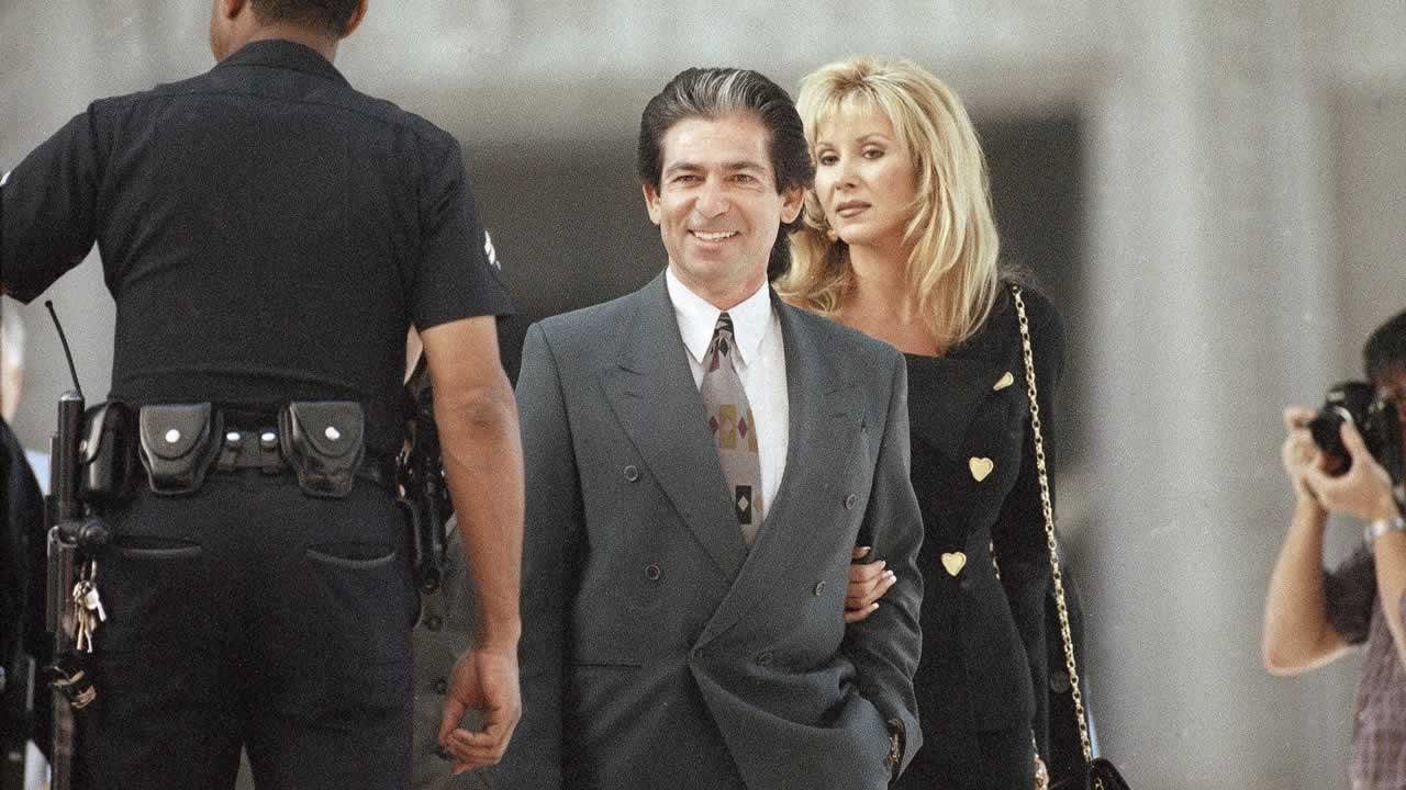 O.J. Simpson's personal attorney and friend Robert Kardashian and his fiancée Denice Shakarian Halicki arrive at the Los Angeles Criminal Courts Building, March 30, 1995.