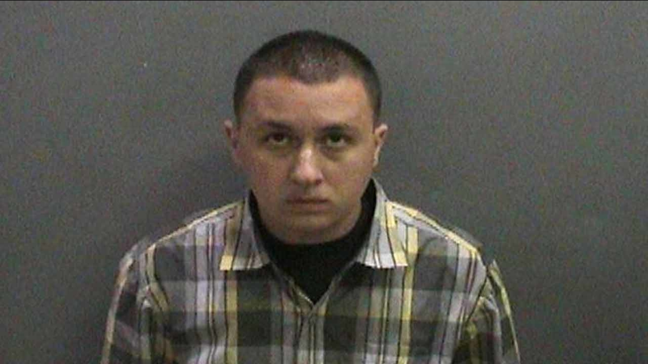 Darreck Enciso, 27, of Adelanto, is seen in a booking photo issued by the Huntington Beach Police Department.