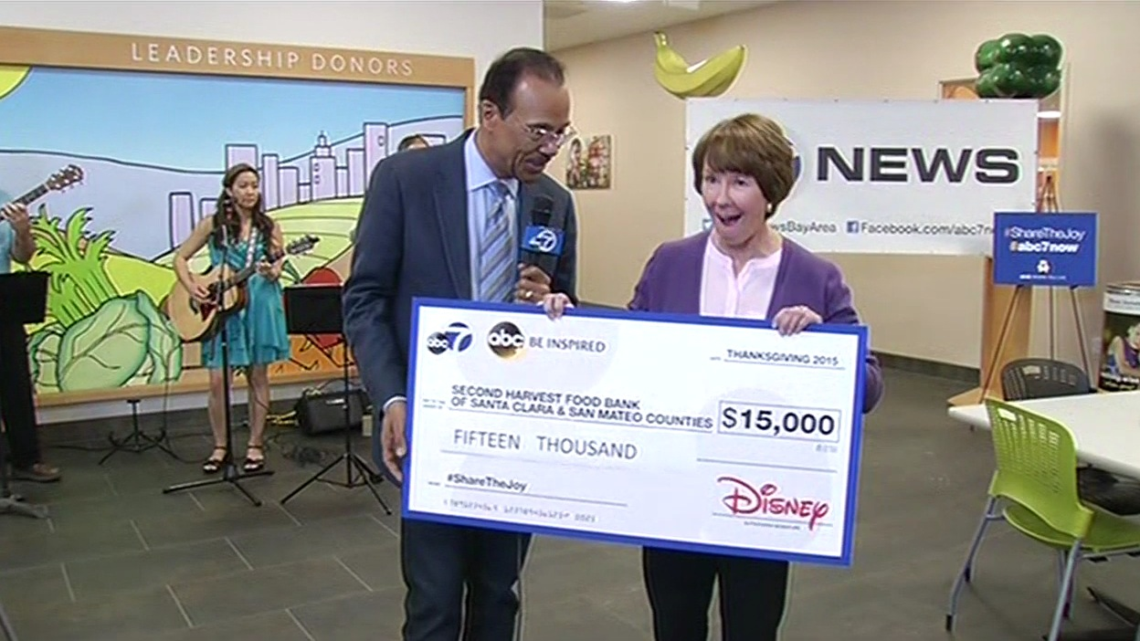 "<div class=""meta image-caption""><div class=""origin-logo origin-image none""><span>none</span></div><span class=""caption-text"">On behalf of ABC7 and Disney, Spencer Christian is seen giving a check to the CEO of Second Harvest Food Bank Kathy Jackson in San Jose, Calif. on Friday, Nov. 6, 2015. (KGO-TV)</span></div>"