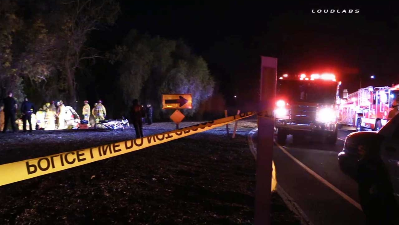 California Highway Patrol officials investigate a fatal crash near the Paramount Boulevard off-ramp of the southbound 5 Freeway in Downey on Saturday, Nov. 7, 2015.