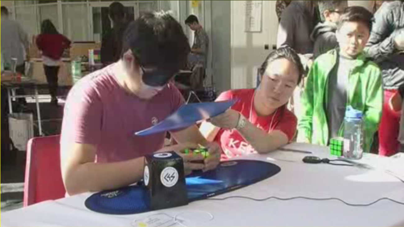 """""""Speed Cubers"""" showed off their incredible speed and fast fingers for top honors in a Rubik's Cube competition on Saturday, Nov. 7, 2015,  in Hayward, Calif."""