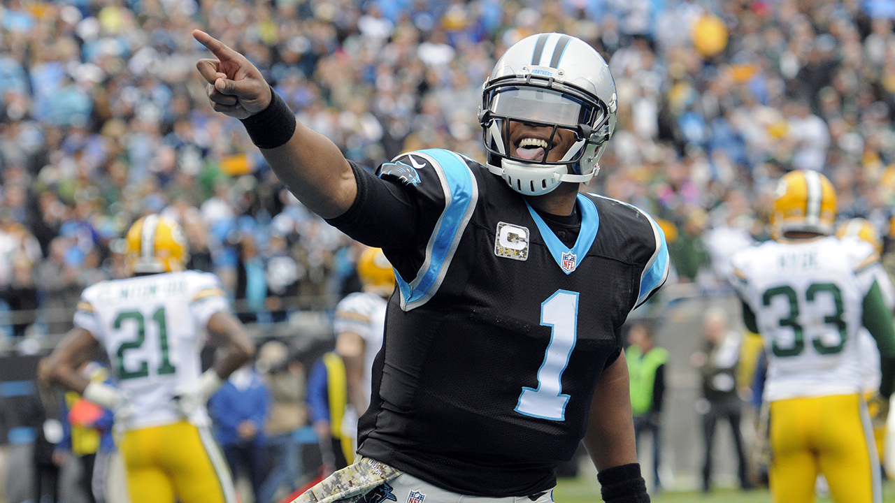 Carolina Panthers' Cam Newton (1) celebrates his touchdown pass against the Green Bay Packers