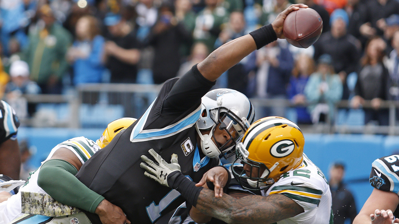 Carolina Panthers' Cam Newton (1) reaches the ball over the goal line for a touchdown against the Green Bay Packers