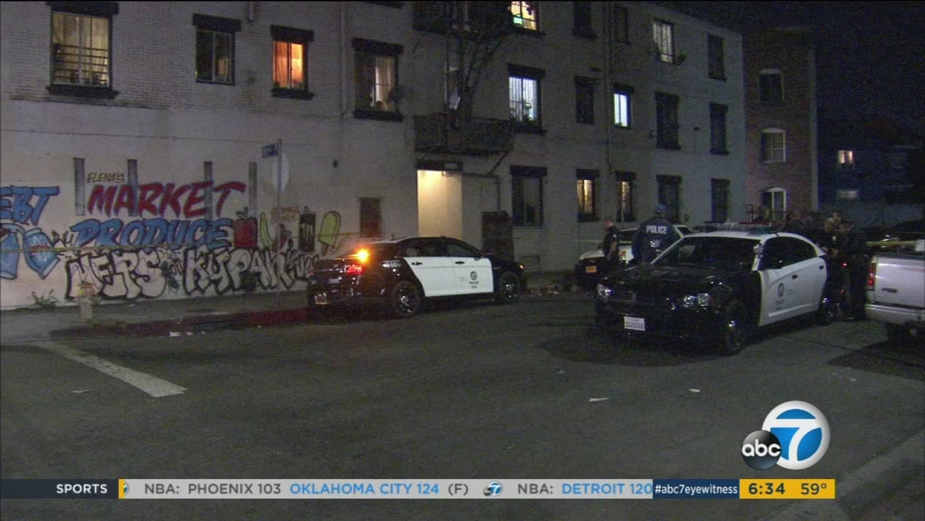 Authorities canvassed an area in the Pico-Union neighborhood of Los Angeles after a shooting left one teen dead and another critically injured on Sunday, Nov. 8, 2015.