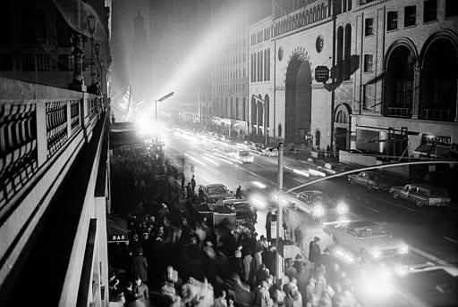<div class='meta'><div class='origin-logo' data-origin='none'></div><span class='caption-text' data-credit='AP Photo/ File'>Forty-second Street in New York City is lit by floodlights and automobile headlights during the massive power failure, Nov. 9, 1965.</span></div>