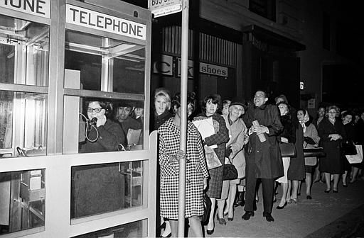 <div class='meta'><div class='origin-logo' data-origin='none'></div><span class='caption-text' data-credit='AP Photo/ File'>Stranded New York workers wait patiently in a long line to use a phone booth to call home, during the massive power failure of Nov. 9, 1965.</span></div>