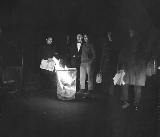 <div class='meta'><div class='origin-logo' data-origin='none'></div><span class='caption-text' data-credit='AP Photo/ File'>New Yorkers burn papers in a litter basket to illuminate a street corner in the midtown Manhattan section of the city, Nov. 9, 1965.</span></div>